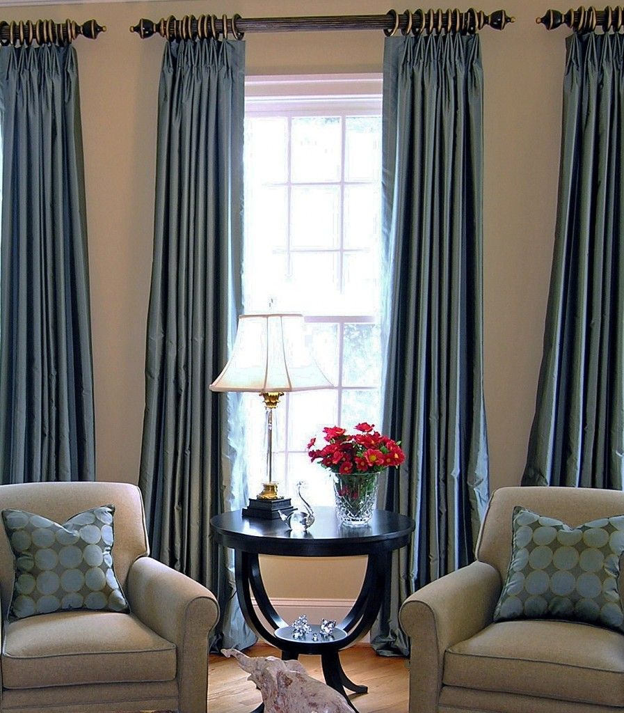 Pleated panels elongate a window and add color texture and warmth