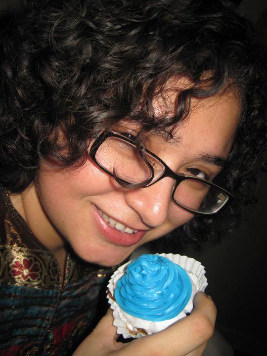 My younger sister tasting one of my first batch of Blueberry Cupcakes with Blue Bird Frosting in Chicago.  http://kinjingles.blogspot.in/  https://www.facebook.com/kinjingles  https://twitter.com/kinjingles