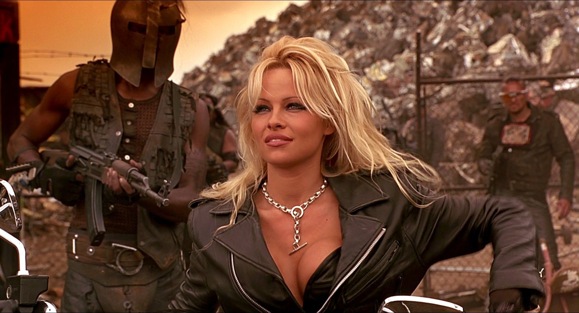 pamela anderson hairstyle pictures | Pamela Anderson in Barb Wire ...