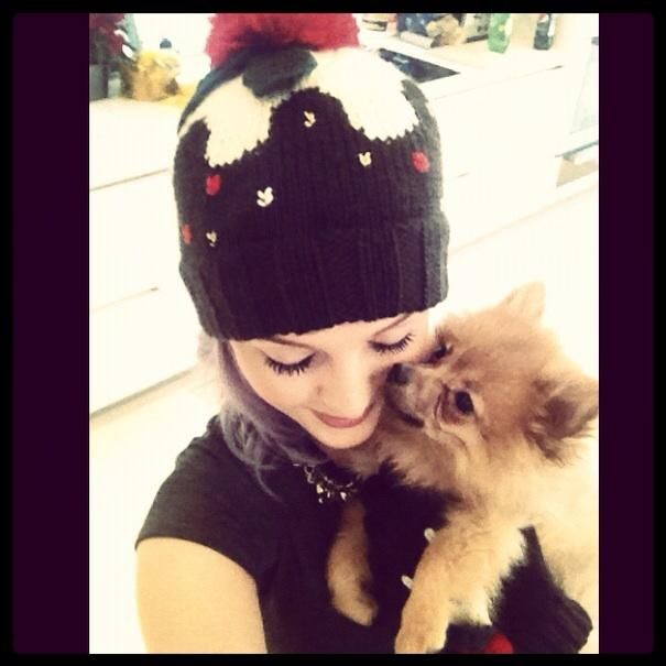Perrie with her and Zayn's dog Hatchi! So Cute!
