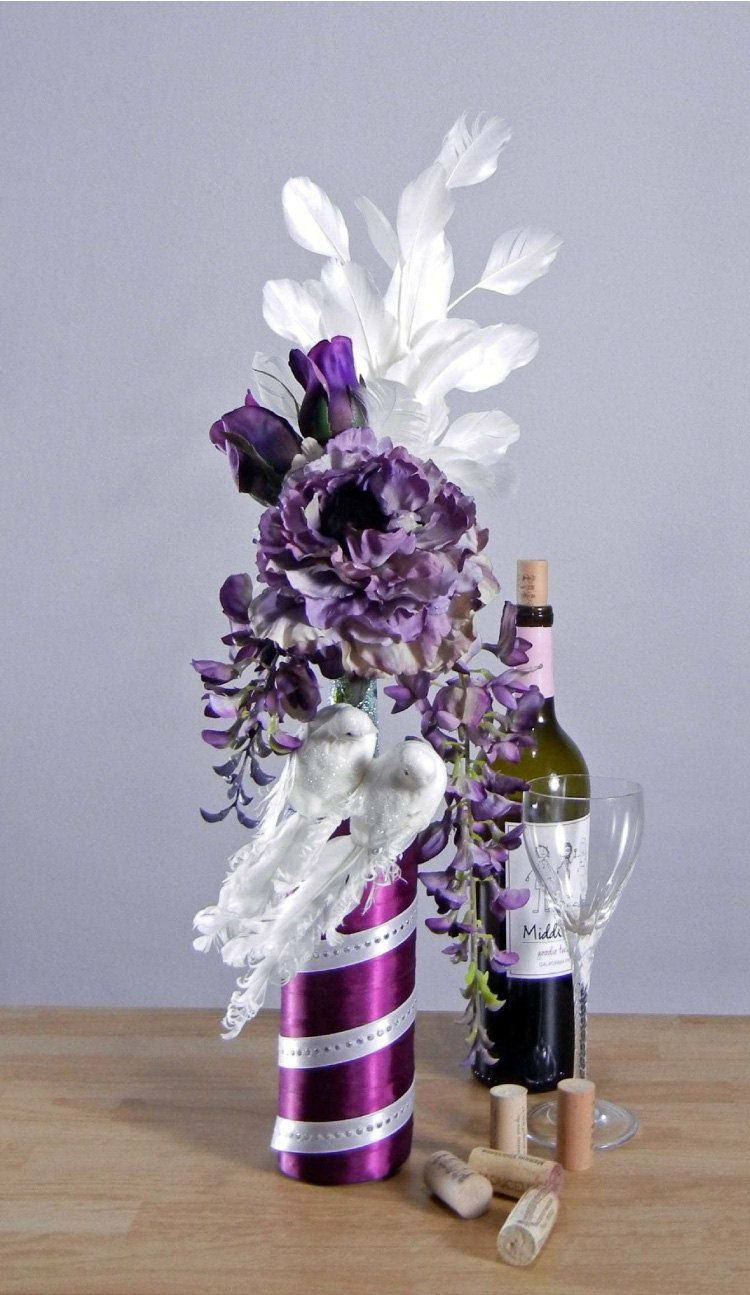 Purple wedding floral arrangement with doves white for Wine bottle flower vase