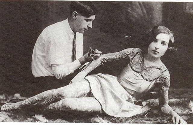 Vintage prostitutes | woman being tattooed, early 1900s.
