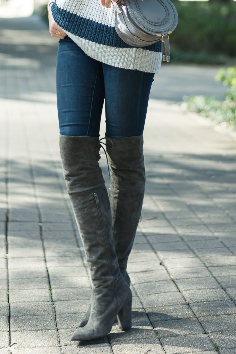 An oversized knit sweater paired with over the knee boots...