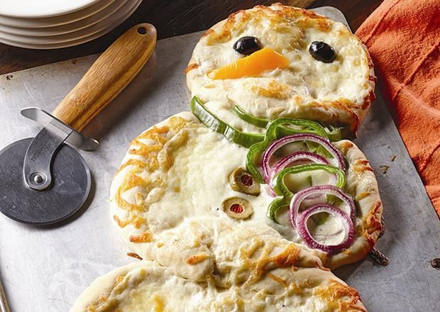 Using Alfredo sauce makes for a whiter snowman but feel free to use pizza sauce if you prefer.  Decorating the snowman is great fun for children of all ages.