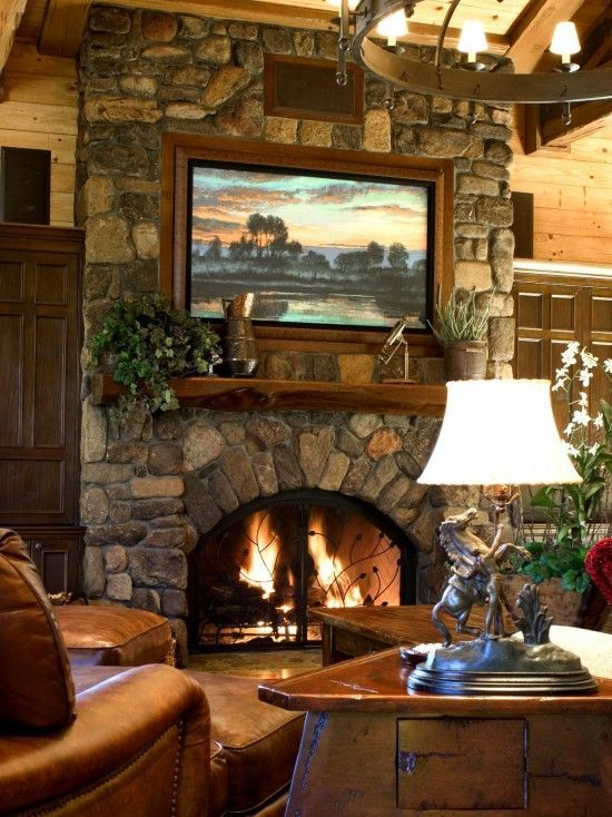 Great Stone Fireplace With Built In Large Screen Tv Above The