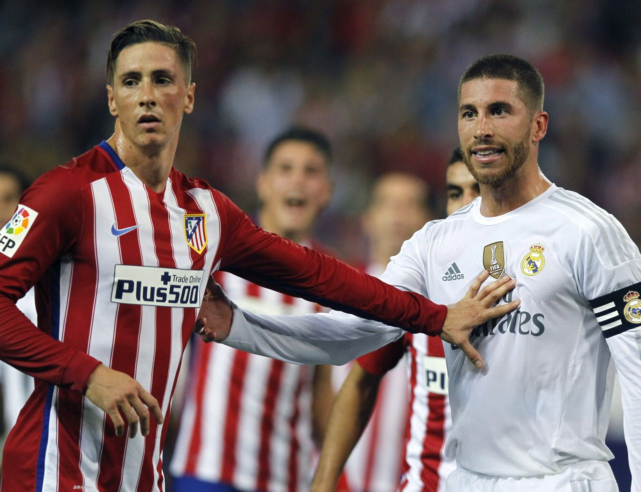 """Ramos: """"Knock it off Torres, quit touching my uniform!"""" Torres: """"Oh, like this?  *Puts hand on Sergio* What are you going to do about it?"""" Ramos: """"This! *Puts hand on Torres*"""" Both:  """"Ref, he won't stop hitting me!"""""""