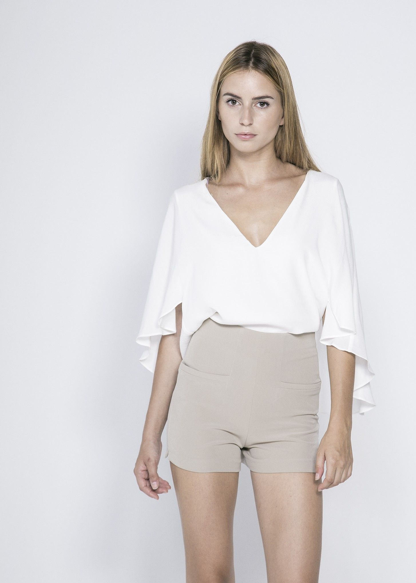 "Beige High-Waisted Shorts with Pockets. Zip back. Material: 95% Polyester 5% Elastane. Model wears UK size S and her height is 5'8"" - £24.99 at www.froww.com"