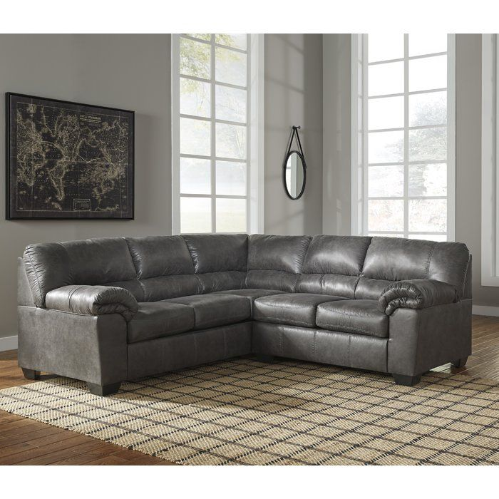 If You Love The Cool Look Of Leather But Long For The Warm Feel Of Fabric You Ll Find The Baronets Sectional Faux Leather Sectional Ashley Furniture Furniture