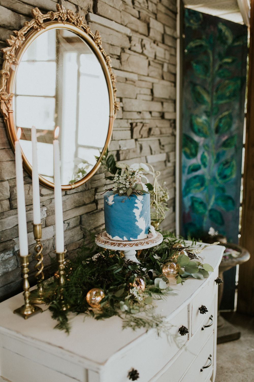 Hang a mirror and decorate on the sides with flowers