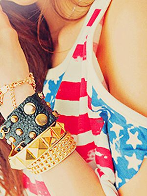 Add some edge to your American girl-next-door appeal with studded cuffs in gold and black.