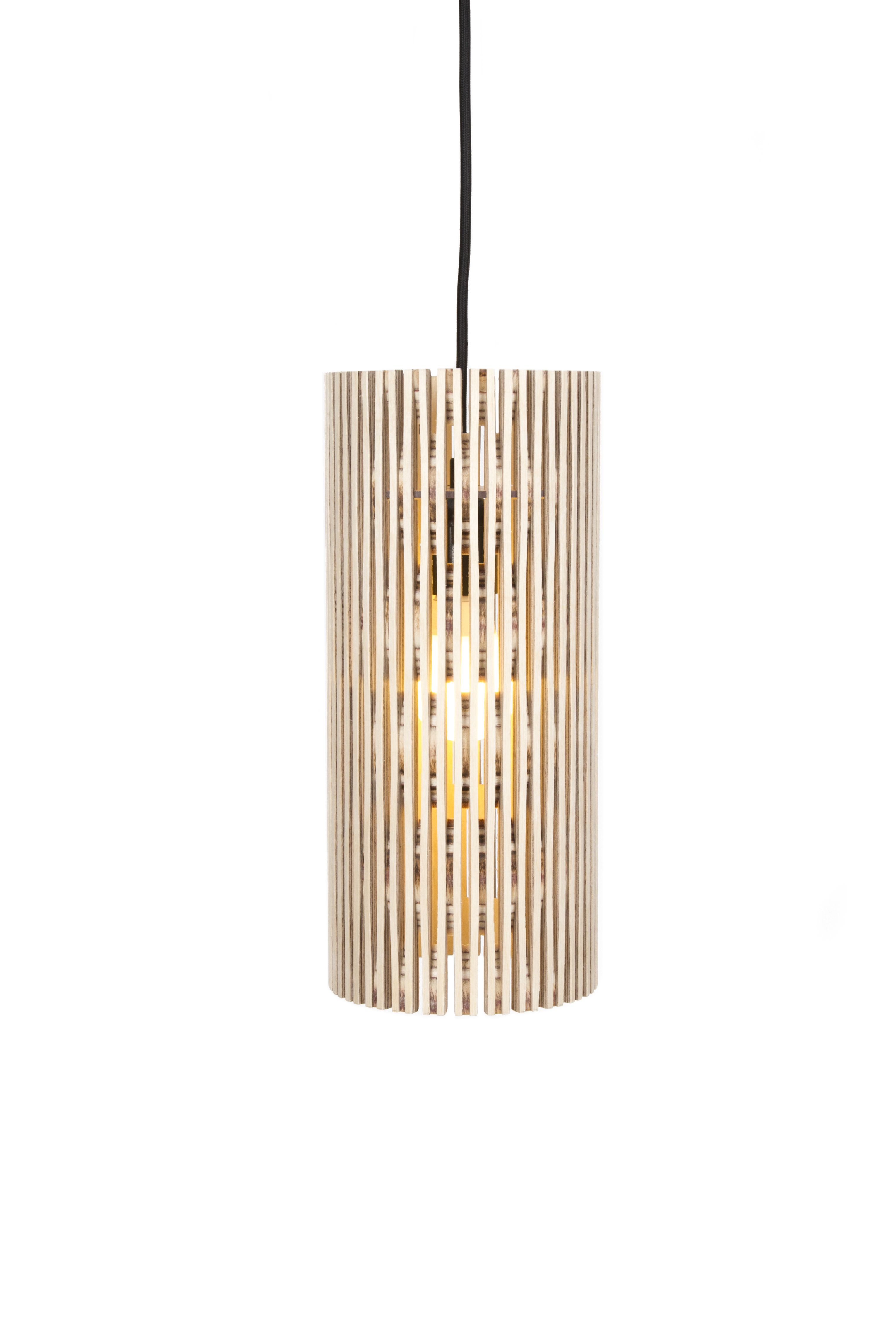 dukta Ora The cylindric luminaire is made from a single