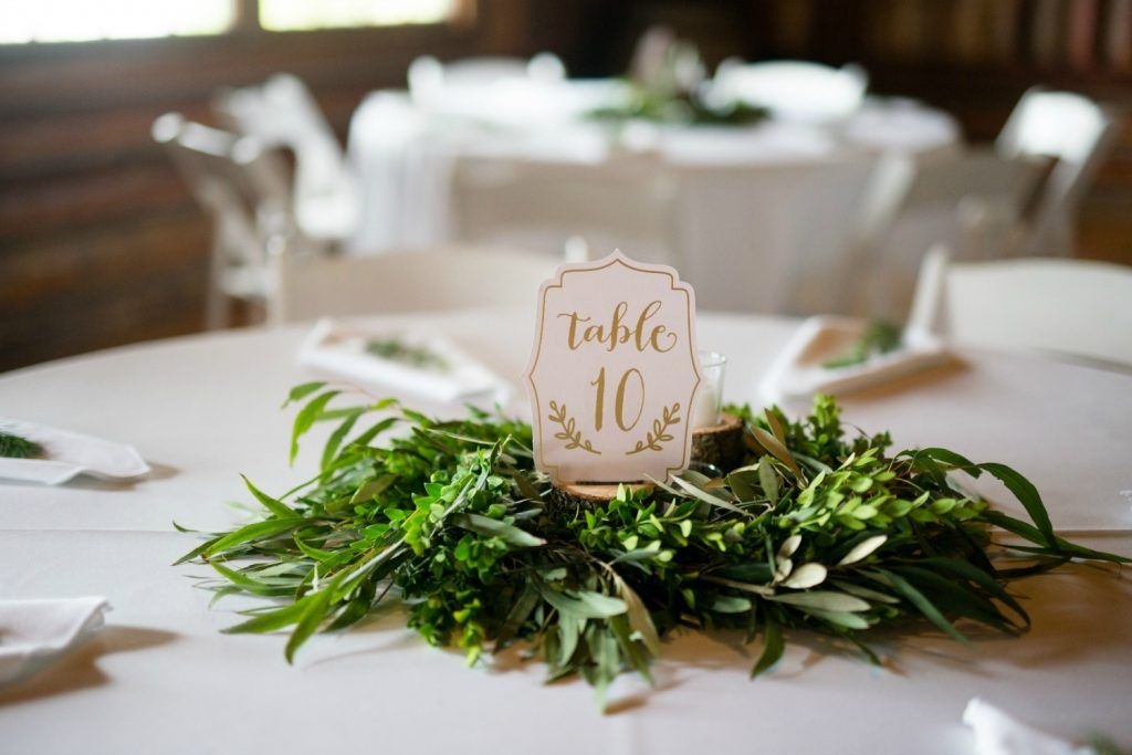 Greenery garland centerpieces for round wedding tables by