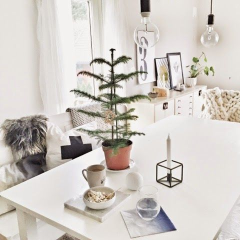 Minimalist nordic Christmas decor. A bit on the bare side for me, but I like the light approach