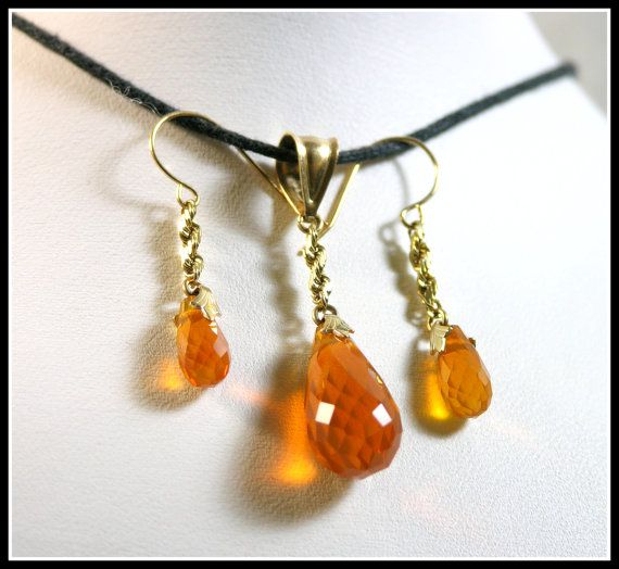 Oregon Fire Opal Briolette Set by GemsoftheNorthwest   14k Gold Fill Settings  Hand mined from the Juniper Ridge Opal Mine in Southern Oregon. The transition from rough opal into this elegant pendant and earring set is breath taking. The drop earrings and briolette cut add sophistication and Simple Elegance. $125