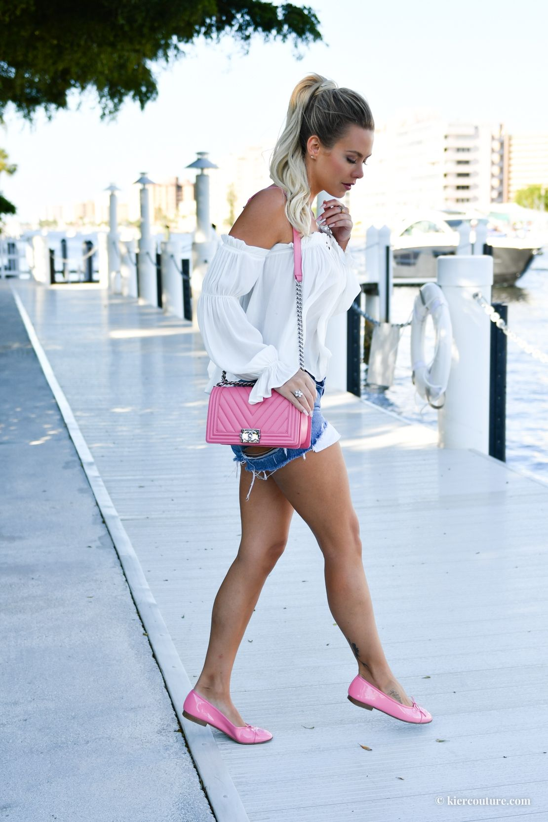 57a453b857237e Kier Mellour in a white peasant top and pink Chanel flats and Chevron boy  bag with vintage levi's shorts and Bellami ash blonde hair in a ponytail