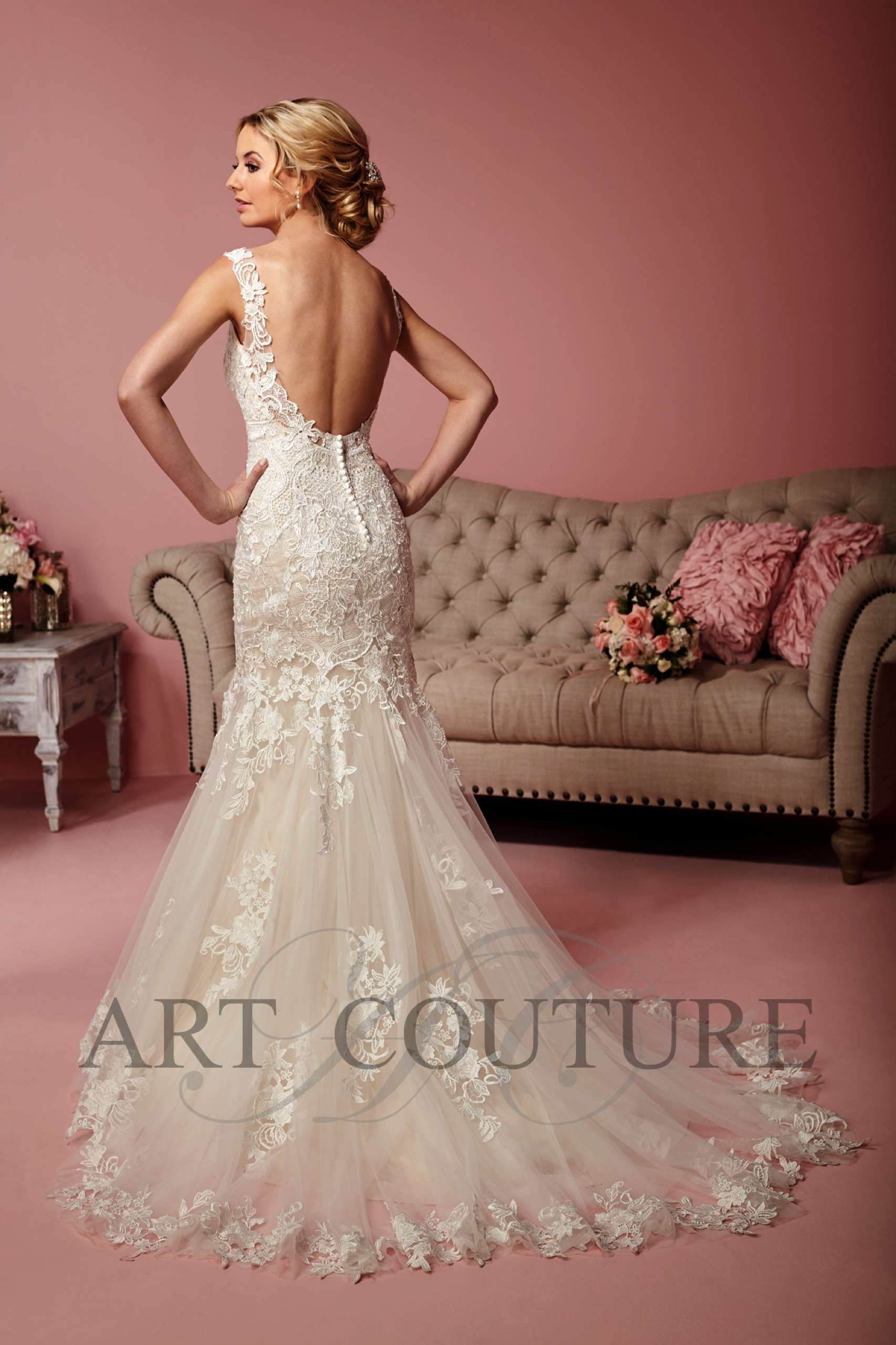 A distinctive beaded lace fishtail wedding dress with exposed back