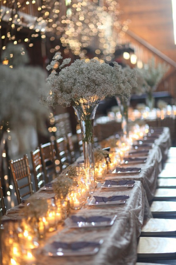 centerpieces of nothing but baby's breath and candles on a long tablescape. quite elegant and clean.