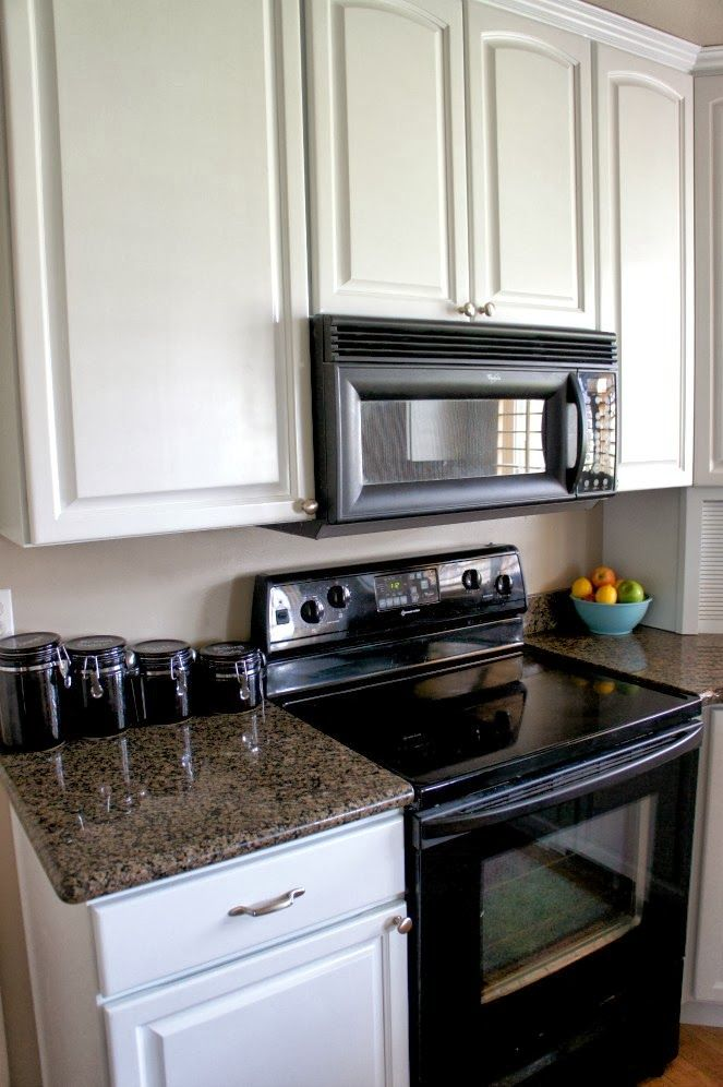 White Painted Kitchen Cabinet Reveal With Before And After Photos And Video 365 Days Of Slow Cooking And Pressure Cooking Kitchen Cabinets With Black Appliances Painting Kitchen Cabinets New Kitchen Cabinets