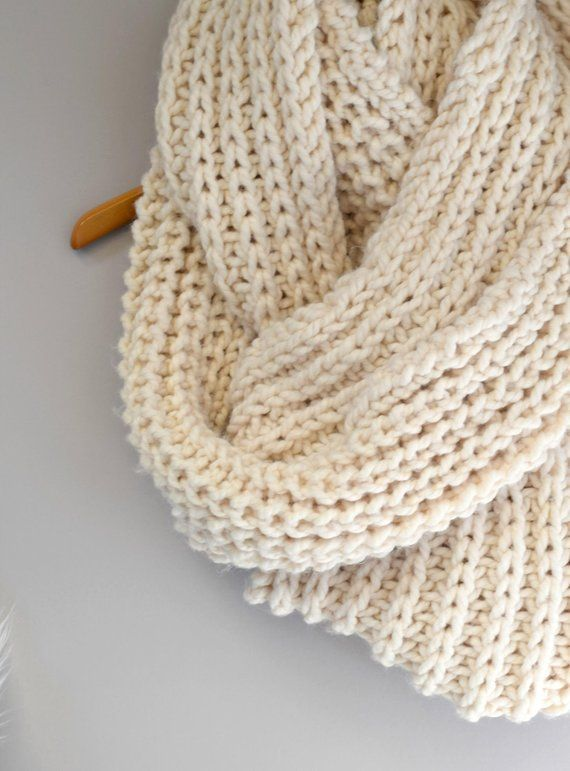 An oversized, cozy, cream colored knit infinity scarf ...