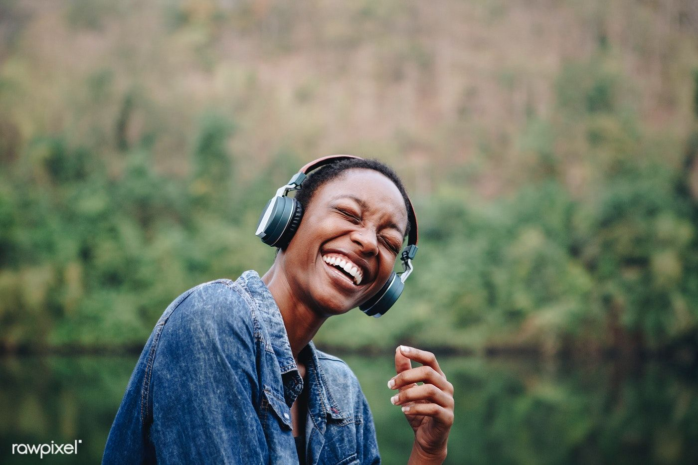 Download premium image of Woman listening to music in nature