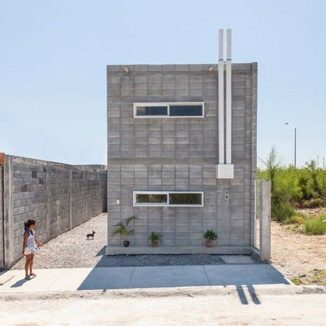 This low-cost concrete block house was designed and built by