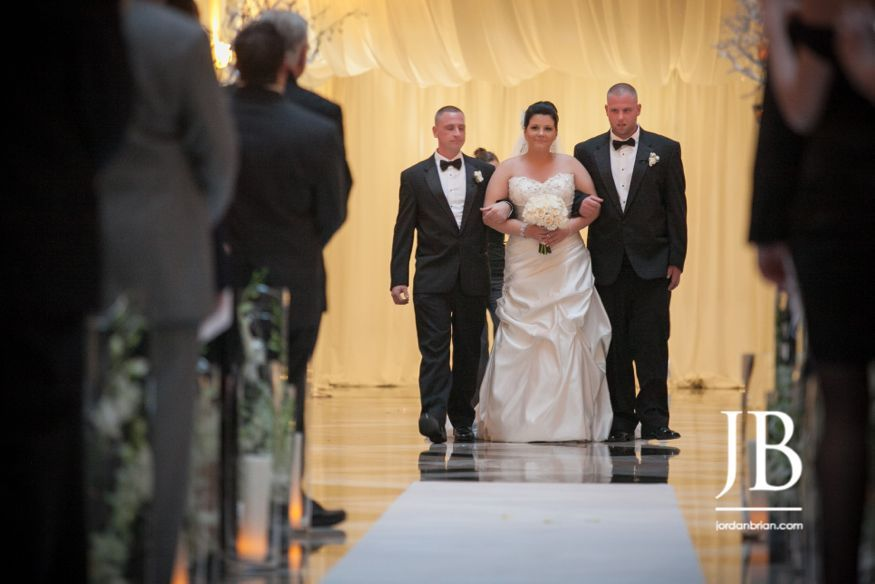 Bride walking down aisle at Curtis Center Wedding. Photos by Jordan Brian Photography.
