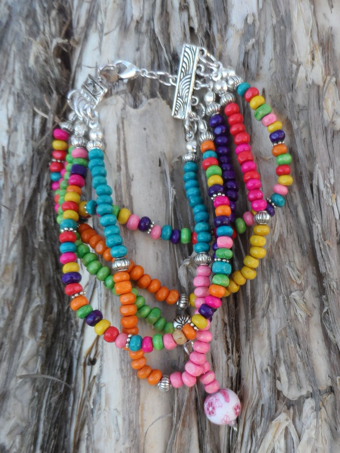 Cheerful and bright string multicoloured wooden bead bracelet