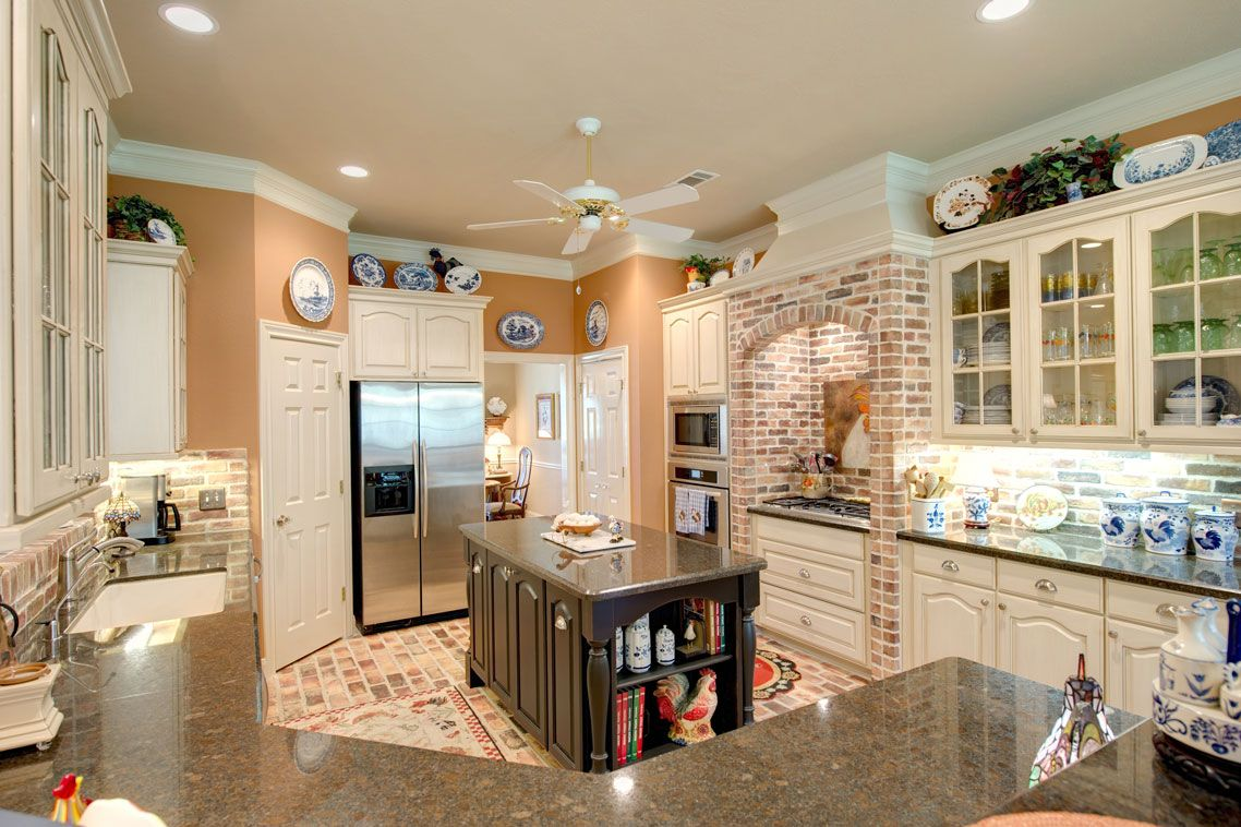 Brick paver flooring custom cabinets with glass front displays and brick paver flooring custom cabinets with glass front displays and granite counter tops dailygadgetfo Images