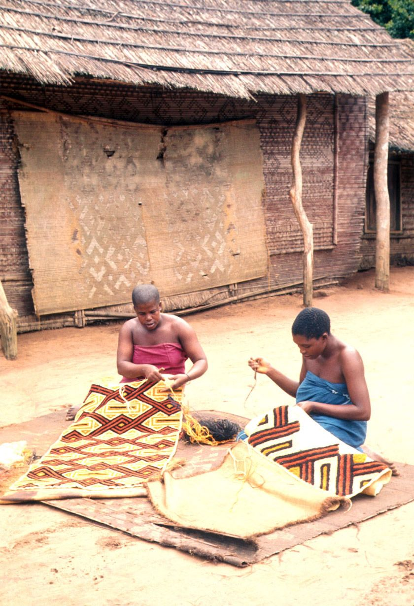 Africa | Kuba women decorating woven cloth, Mushenge, DR Congo