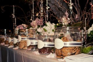 A Dessert Bar With Labeled Cookie Jars