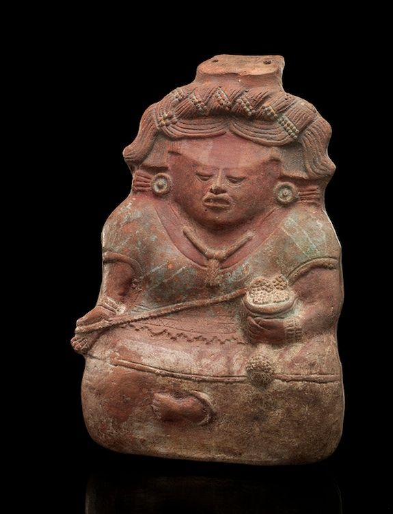 This elaborate piece of pottery is actually a musical instrument. Classic period Maya whistle representing a seated woman, AD 600–900 Quiché Department, Guatemala Pottery