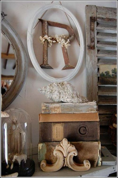 Oval frames, big letters, shutters, old books, glass domes, architectural pieces = LOVE