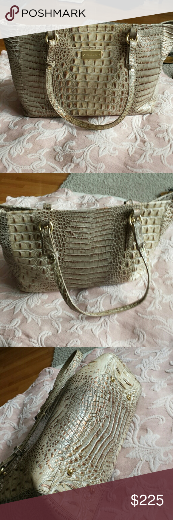 Brahmin bag with dust cover Beautiful Brahmin bag great condition has two zippered pockets on the inside to regular Pockets - pen holders ,has zipper closure one nice large pocket on the outside for your phone ,  the bottom measures 13.5 across and 10 inches from the top handle drop  is 10 inches   beautiful bag with tans and Browns and a copper Sheen to it  feet on the bottom very very good condition no wear on the corners Brahmin  Bags Totes