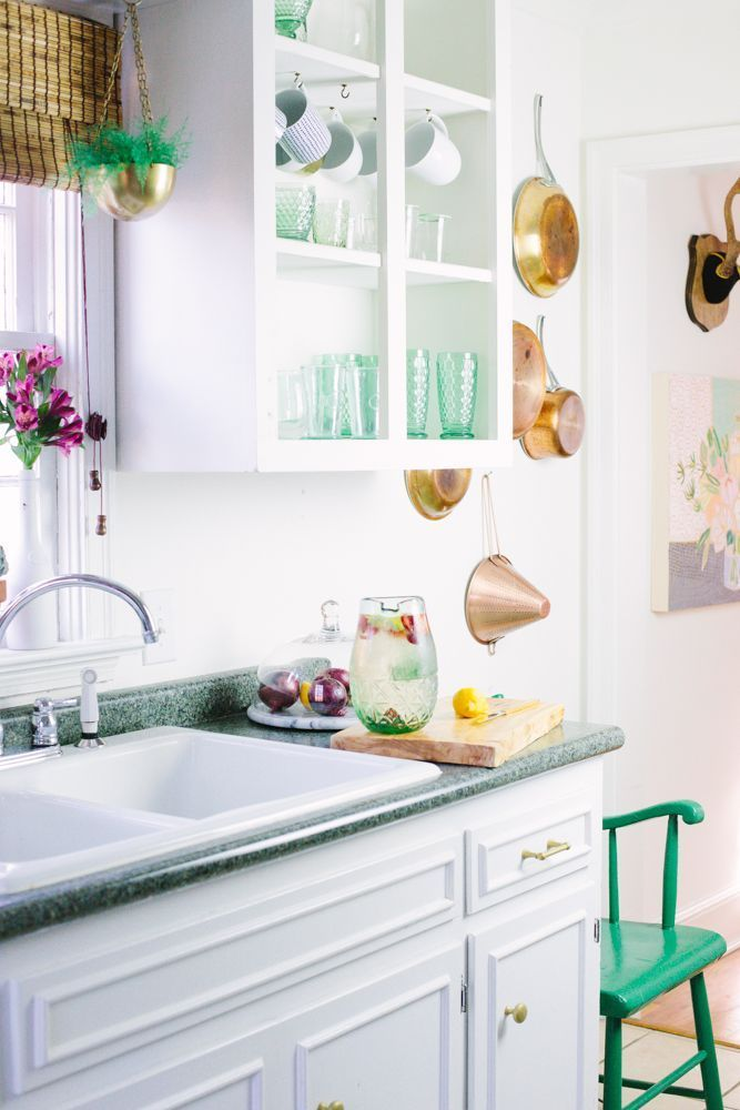 25 Small Kitchen Design Ideas | Storage solution and decor tricks to maximize your space | hang pots and pans on the walls  | @stylecaster