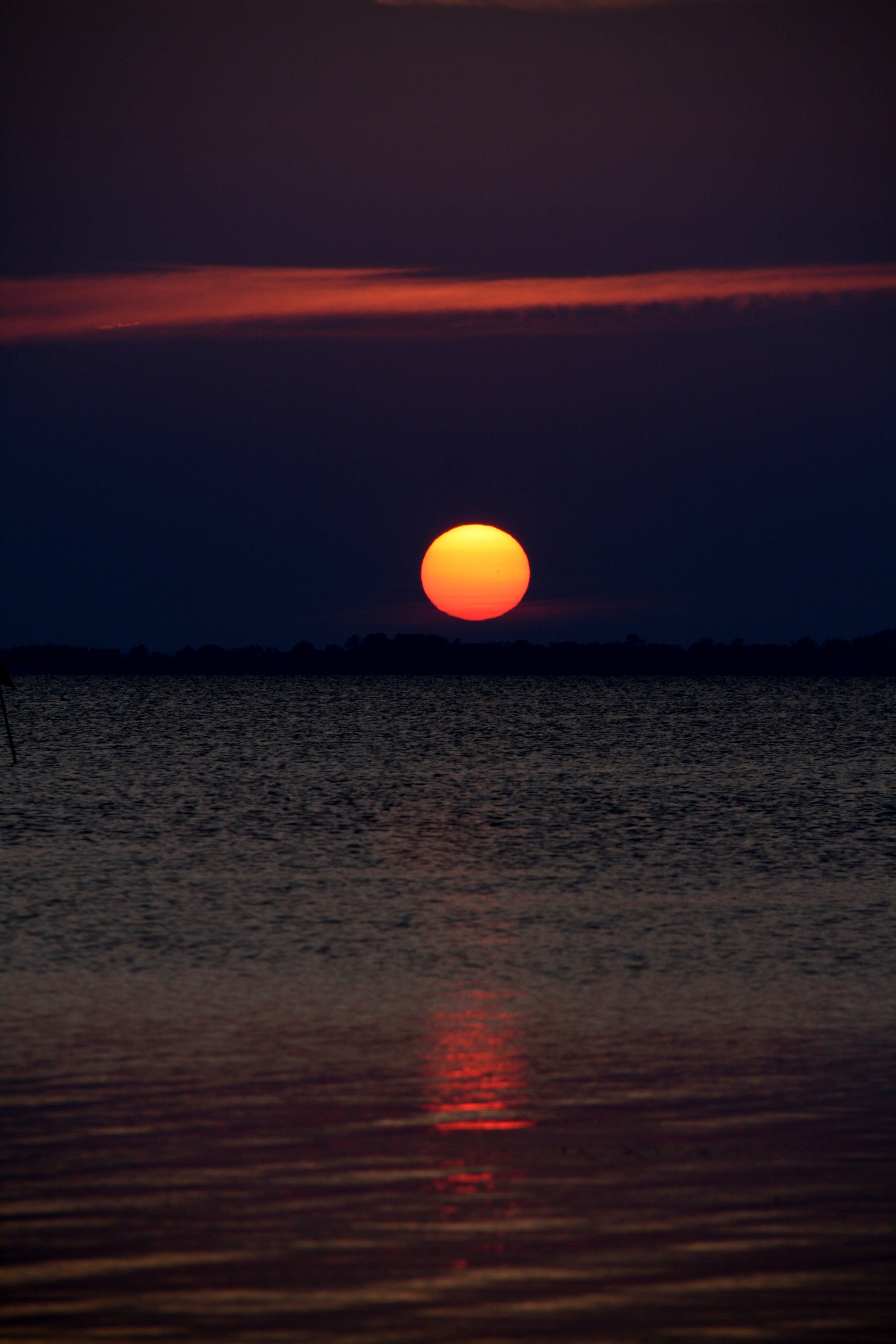 Sunset on the Currituck Sound. Photo by Chet Desai. Entry in the Outer Banks Photo Contest sponsored by Village Realty. www.VillageRealtyOBX.com