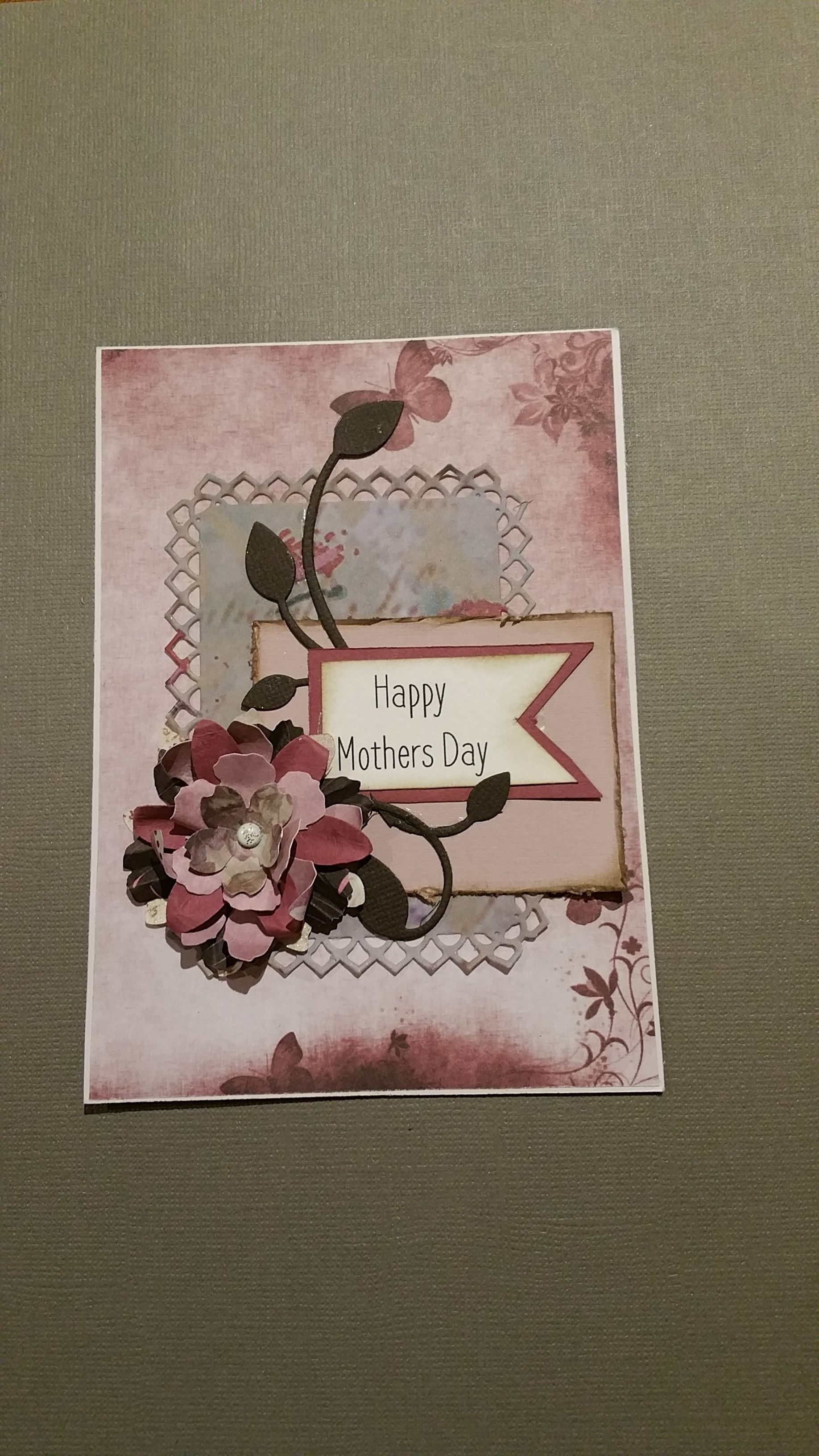 Distressing and inked, diecut central motif and flourish. Hand made Tim Holtz Tattered Florals flower embellishment