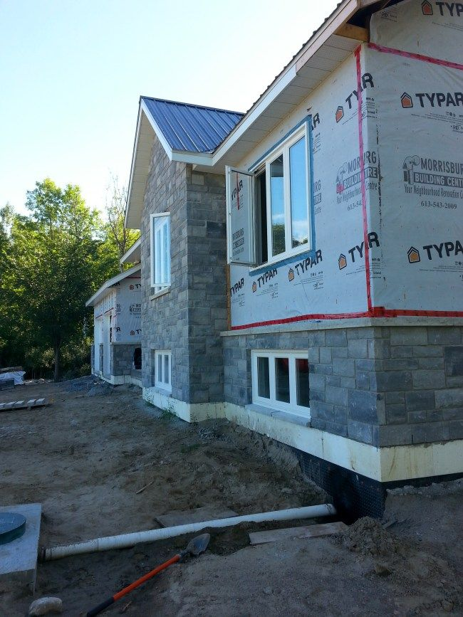Week 18 Modular Exterior Stone On A New Home Construction The Vanderveen House Home Construction Exterior Stone New Home Construction