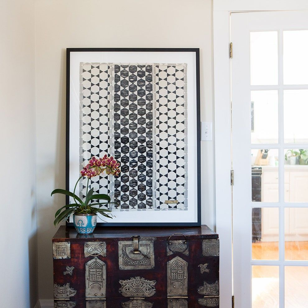 This black and white, modern, graphic, St Frank piece is handmade by artisans in Senegal working in traditional techniques and custom framed to order.