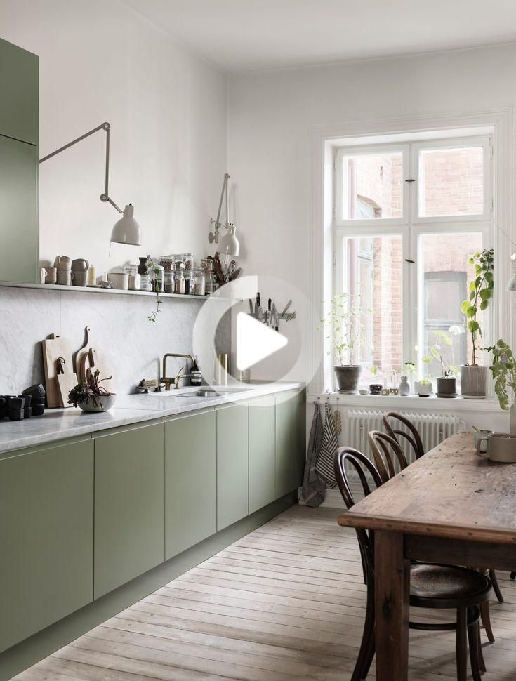 Neutral tones, soft fabrics and plenty of artwork in the cozy Malmö apartment of Nina Persson #kitcheninspiration