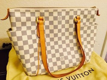 Louis Vuitton Totally Pm Shoulder Bag. Get one of the hottest styles of the season! The Louis Vuitton Totally Pm Shoulder Bag is a top 10 member favorite on Tradesy. Save on yours before they're sold out!