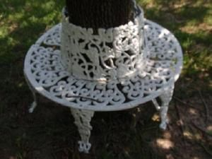 A Wrought Iron Circular Bench Fits Perfectly Next To This Tree