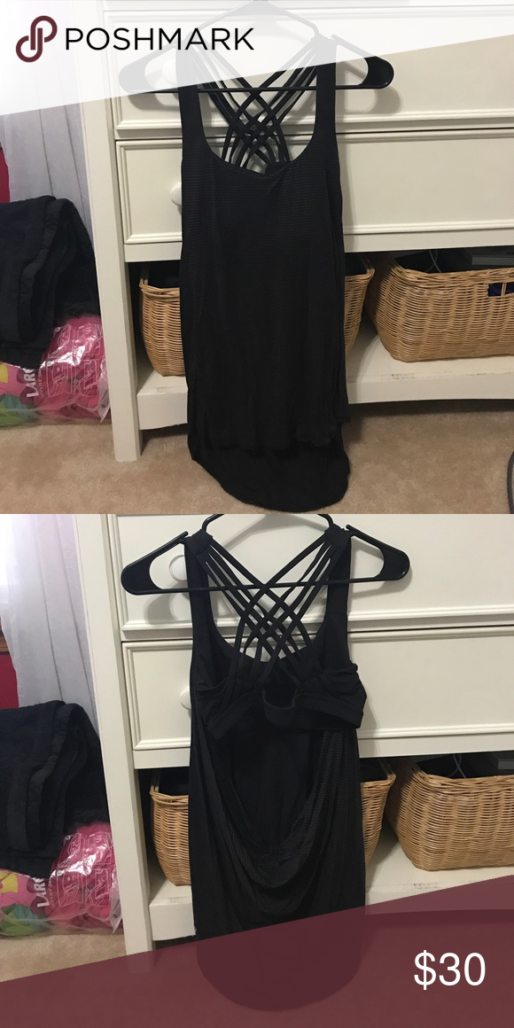e1135df876b Lululemon tank top Black tank top, sports bra built in, swoops in the back  for cute open back design! Worn about 5 or 6 times. lululemon athletica Tops  Tank ...