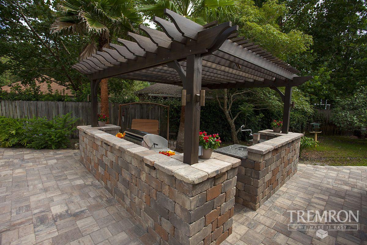 Grill Relax Entertain Time To Enjoy A Tremron Outdoor Kitchen Retainingwalls Outdoorkitchen Ou Hardscape Design Outdoor Kitchen Design Backyard Design