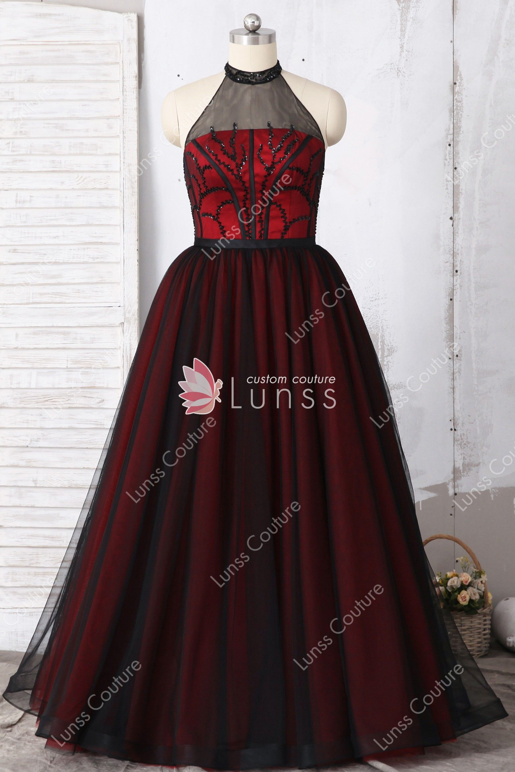 9ca1889311 This unique two-tone black red A-line prom dress features illusion halter  neckline