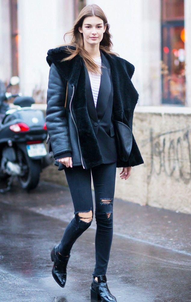 Ophelie Guillermand in a black jacket, ripped skinny jeans, and black ankle boots #autumnfashionover40winter #skinnyjeansandankleboots