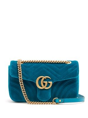520622cc4d69 Gucci's petrol-blue velvet GG Marmont bag is brimming with charm. The  chevron-