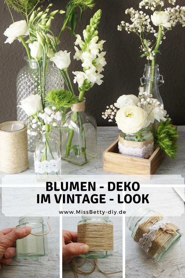 Frhlingsdeko Tisch Dekoration selber machen mit weien Ranunkeln und Schleierkraut im Vintage