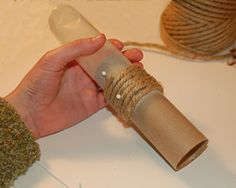 Napkin Ring - photo of sliding out tube -  wax paper around a paper tube.  hot glue rope around the tube, slide off tube and pull away wax paper. #papernapkins