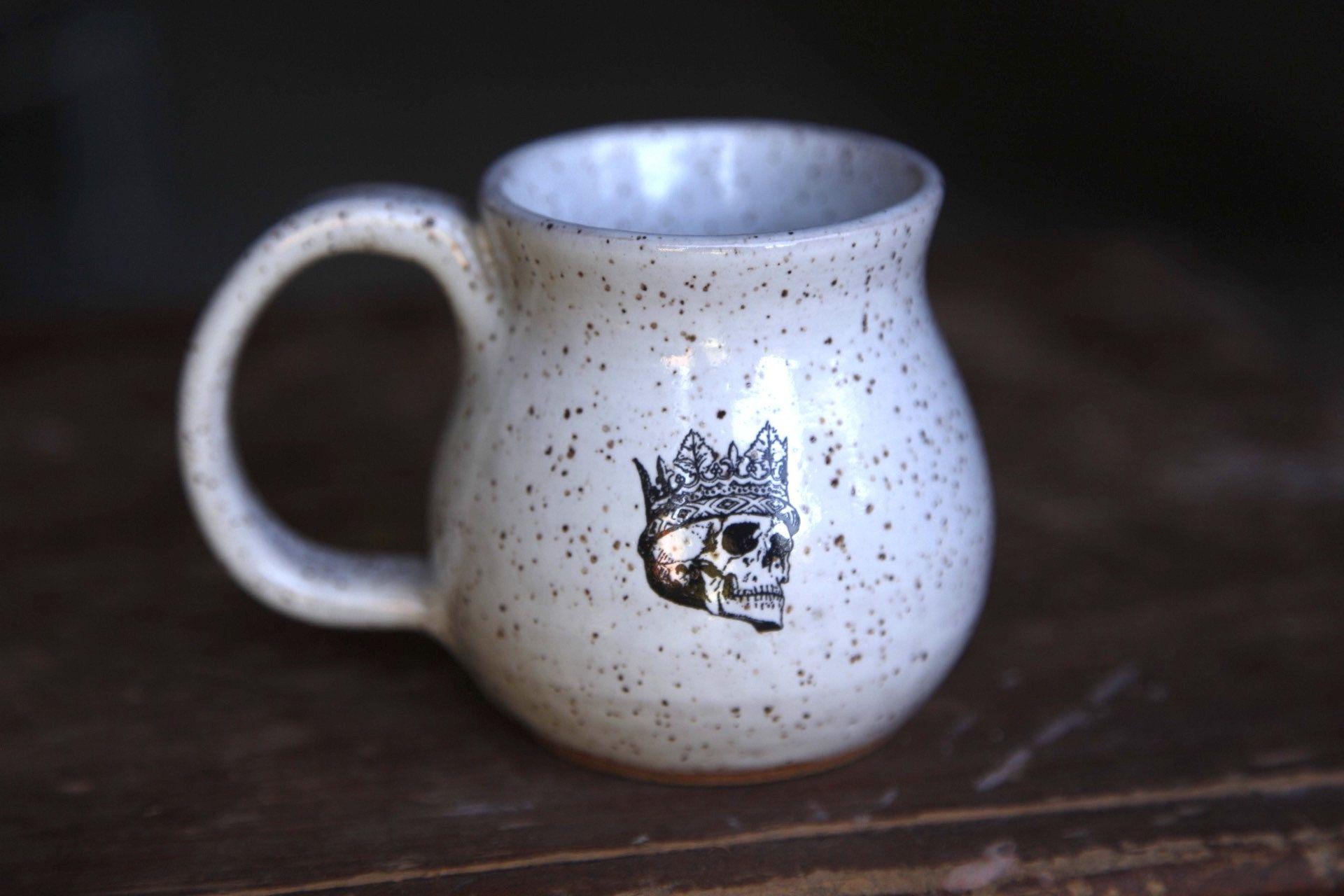 Handmade white speckle ceramic coffee mug with skull and