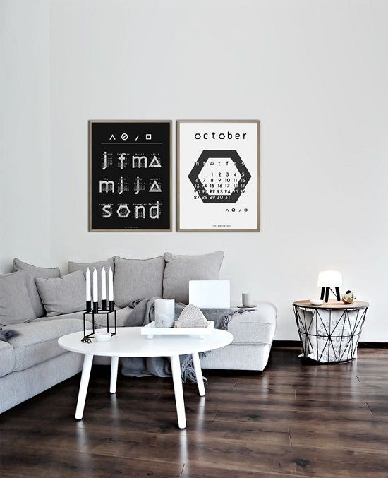 Grey couch and typographic poster
